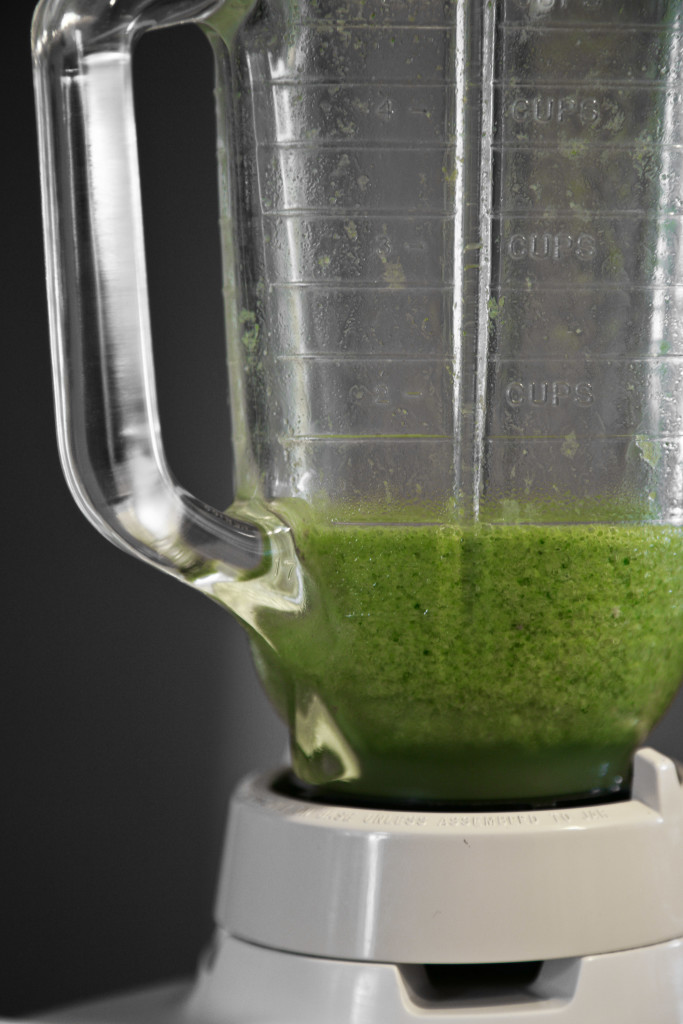 Mixing up some green smoothie.